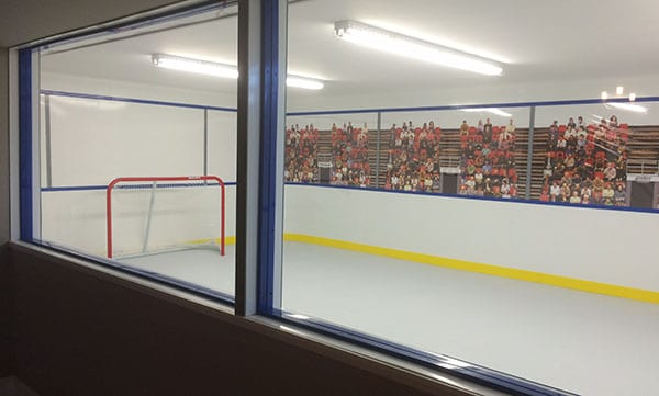 An indoor artificial ice rink by KwikRink
