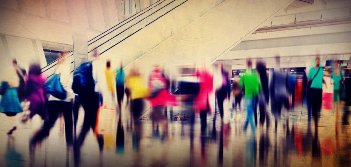 Long exposure image of colorful people walking around a shopping mall