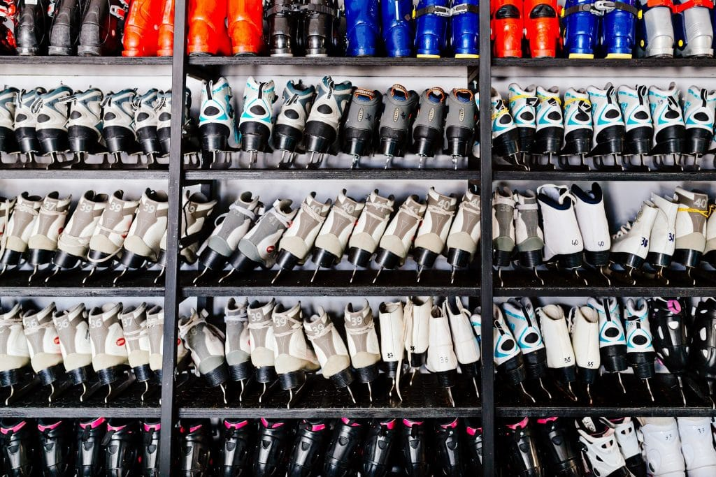 Ski boots and ice skates on shelf