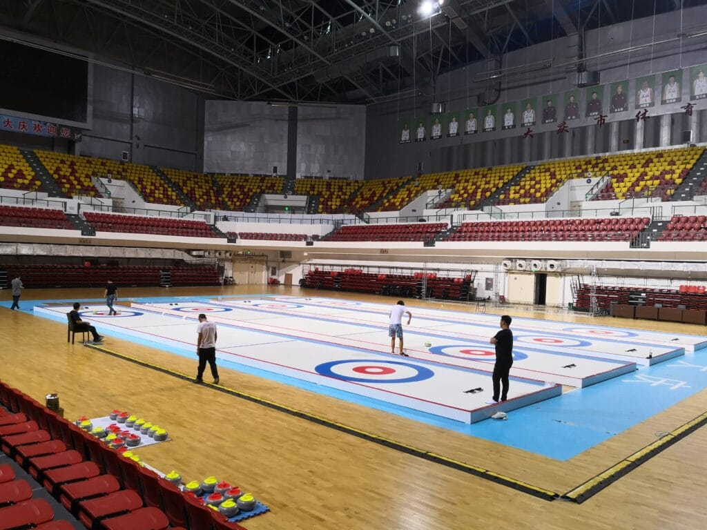 curling lanes on synthetic ice tiles