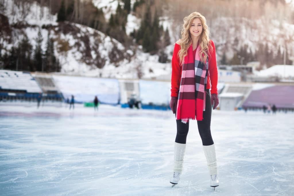 woman ice skating outdoors on a home ice skating rink
