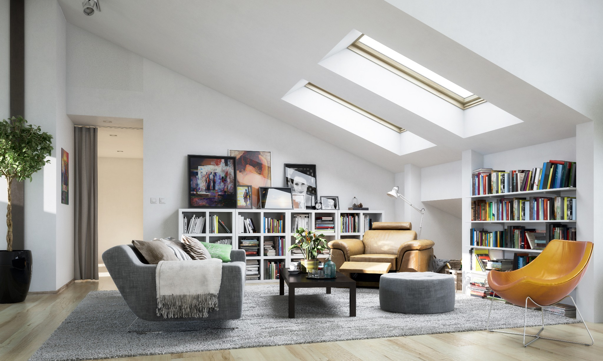 A modern style library bonus room with bright furniture and skylights in a slanted roof.